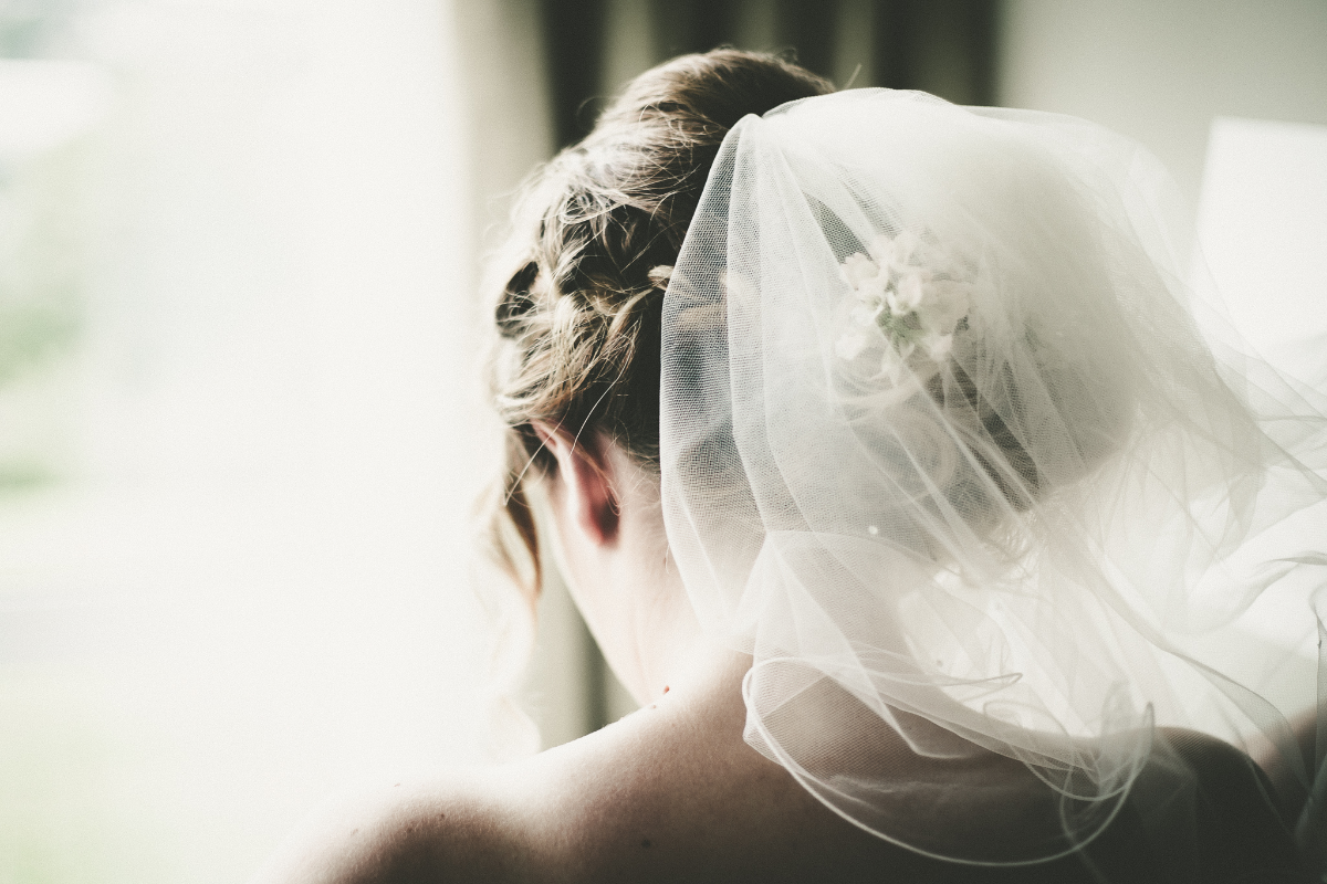 close up black and white bride shot with veil